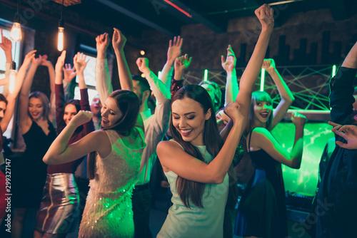 Spoed Fotobehang Wanddecoratie met eigen foto Portrait of positive cheerful elegant girlfriends crowd people celebrate noel party dance on discotheque have fun feel rejoice wearing formalwear dress in green neon lights