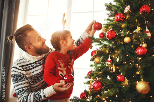 Foto op Canvas Wild West happy family father and child girl decorated Christmas tree