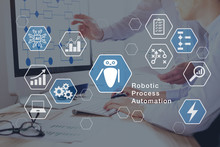 Robotic Process Automation (RPA) Technology Automate Business Tasks With Direct Integration Of Robots In Company Software User Interface, Concept With Icons And People Working In Office On Computer
