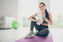 Full Body Photo Of Active Girl Doing Yoga Aerobics Want Relax Rest Open Plastic Bottle With Water Sit Violet Purple Carpet Having White Towel On Shoulder In House Like Fitness Studio