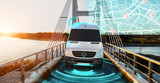 Fototapeta Kawa jest smaczna - Autonomous Electric car driving on a highway with technology assistant tracking information, showing details.