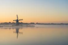 Nature Awakens At A Traditional Dutch Windmill During A Foggy Dawn. De Helper, Groningen.