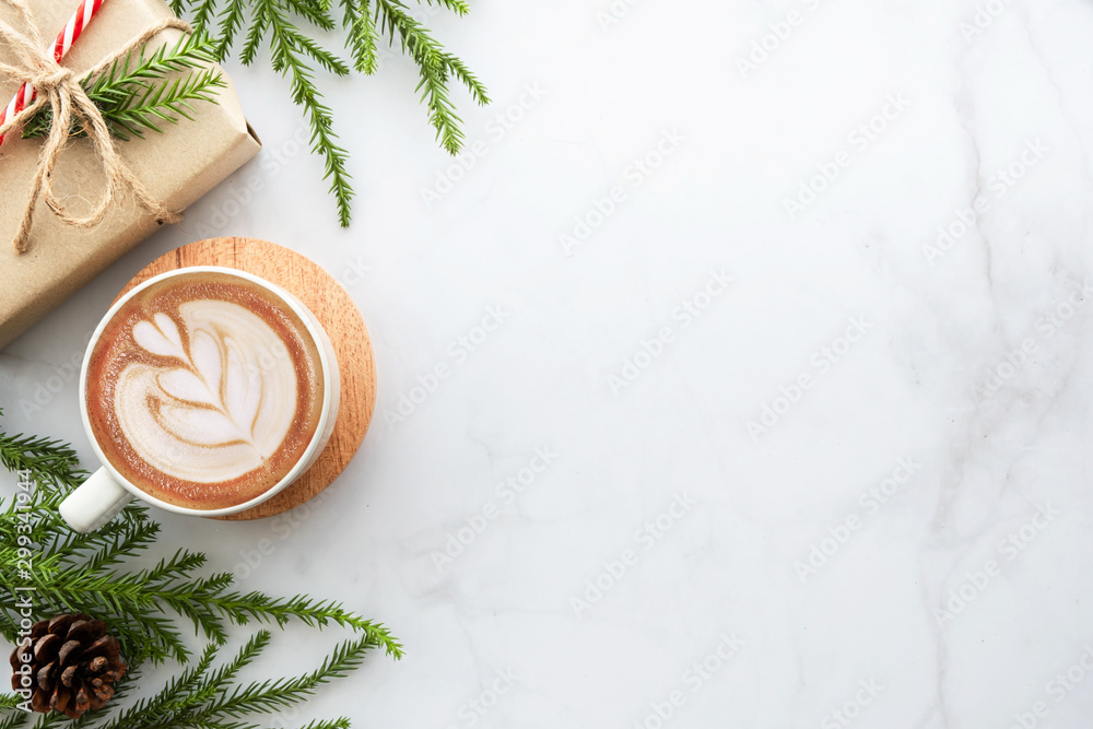 Fototapety, obrazy: White marble table with cup of latte coffee and Christmas decoration with gift box. Christmas and new year celebration concept. Top view with copy space, flat lay.