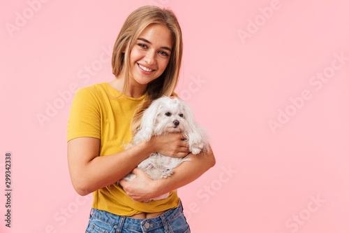 Beautiful lovely girl holding her pet lapdog - 299342338