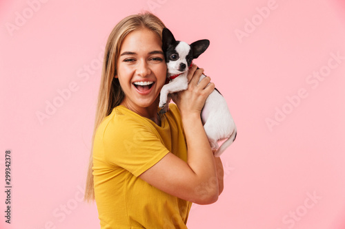 Cute lovely girl playing with her pet chihuahua - 299342378