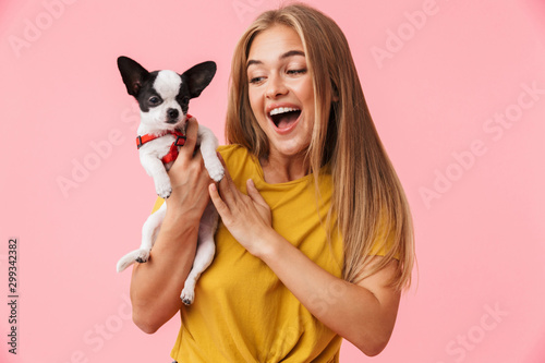 Fotografia, Obraz Cute lovely girl playing with her pet chihuahua