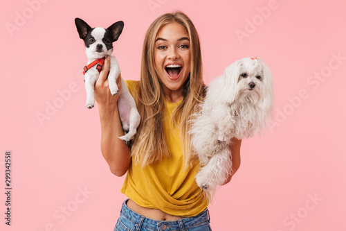 Cute lovely girl playing with her pet chihuahua Canvas Print