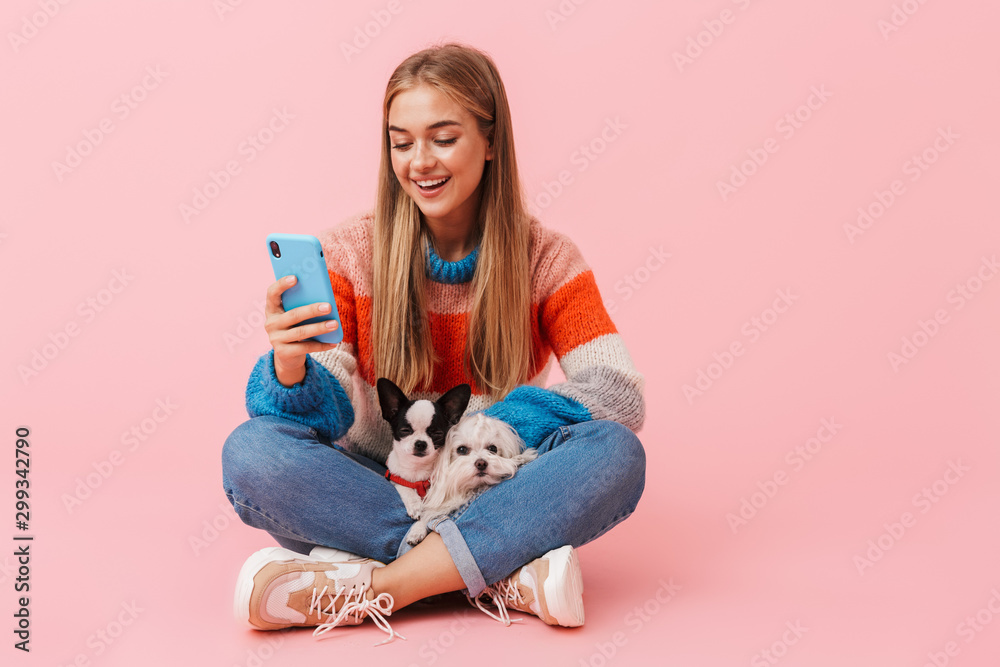 Fototapety, obrazy: Cute lovely girl wearing sweater sitting with legs crossed