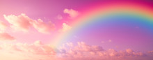 Fantasy Magical Rainbow On Colorful Sky With A Lot Of Pink, Purple And Fluffy Clouds. A Landscape For A Unicorn.