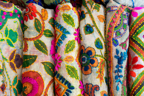 multicolored Indian women's shawls made of silk and cotton in the shop window Wallpaper Mural