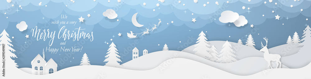 Fototapeta Winter landscape with deer paper cut-out and fir trees in snow. Festive horizontal banner with text Merry Christmas, Village and flying santa's sleigh in night sky with stars, snowfall and moon.