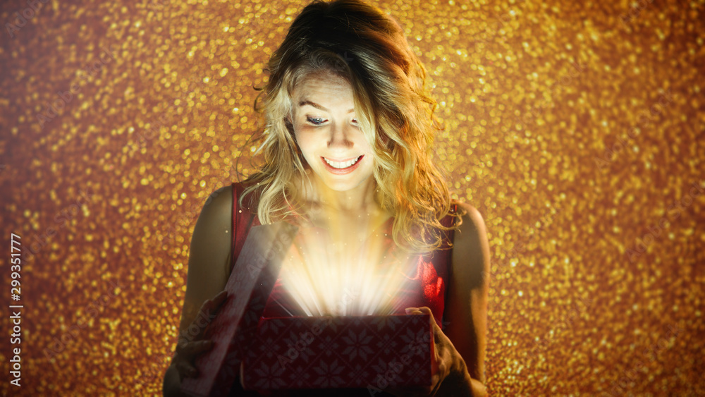 Fototapety, obrazy: attractive girl opens a present