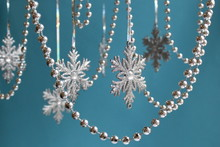 Silver Snowflakes With A Garla...
