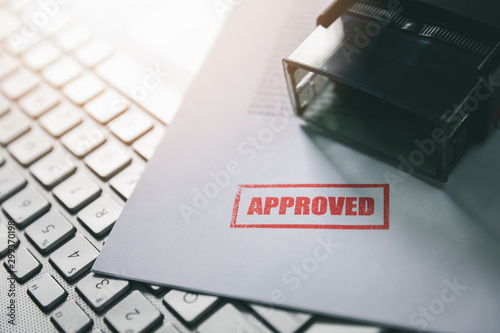 document with approved stamp on computer keyboard Wallpaper Mural
