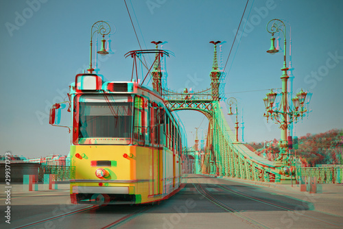 Photo Historic tram on Freedom Bridge in Budapest, toned image, 3D anaglyph effect