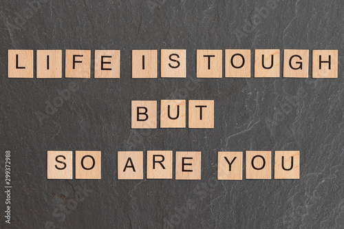 Fototapeta Life Is Tough But So Are You Written With Game Tiles