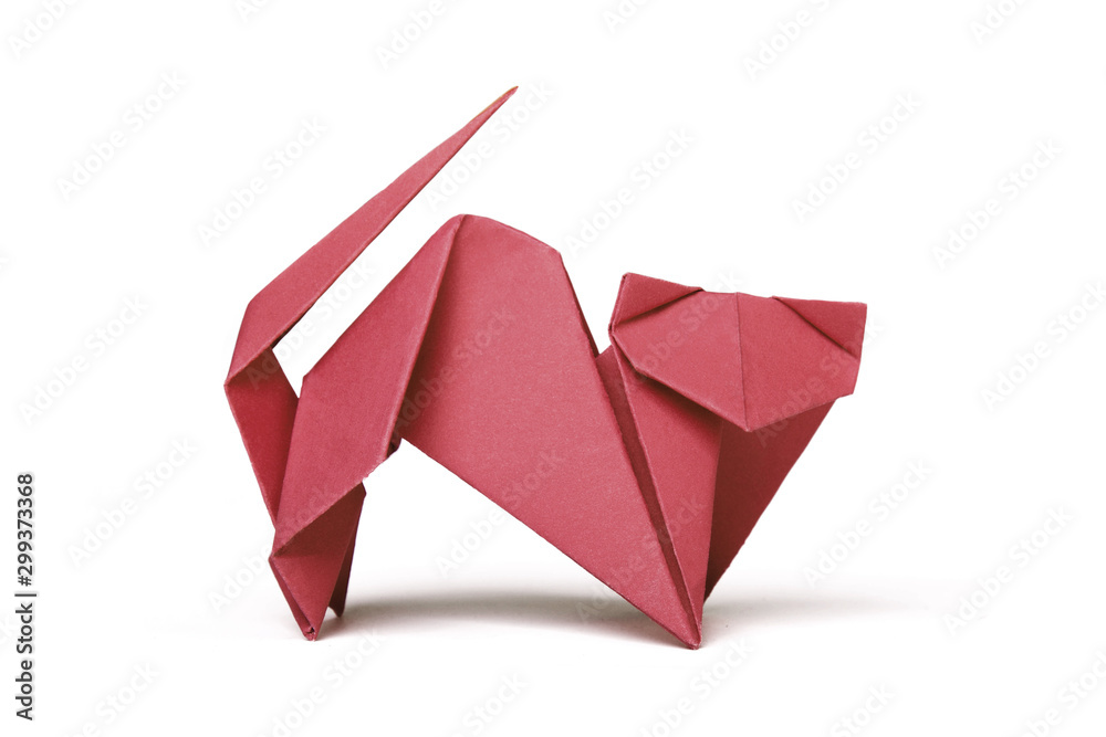 Fototapeta Small red brown origami cat on a white background