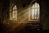 Stained glass windows with sun rays pouring in