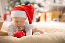 Little Baby In Santa Hat Playi...
