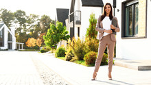 Beautiful Real Estate Agent With Documents Outdoors