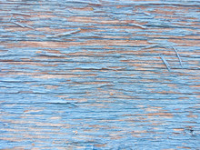 Wood Texture With Blue Flaked Paint. Peeling Paint On Weathered Wood. Old Cracked Paint Pattern On Rusty Background. Chapped Paint On An Old Wooden Surface