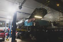 Classic Muscle Car Getting Repairs In A Garage