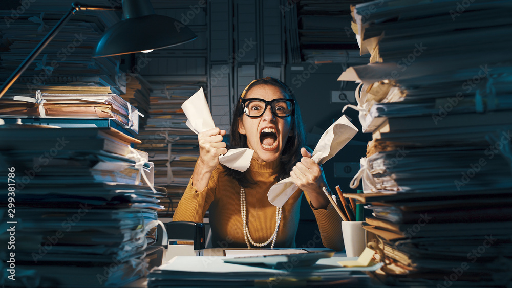 Fototapeta Angry stressed office worker overloaded with paperwork