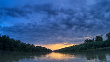 Beautiful Bright Dramatic Sunset Over Danube River With Forest Along Riverside