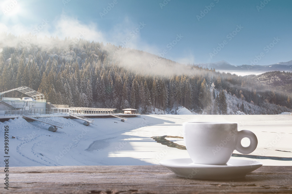 Fototapety, obrazy: Single tea or coffee cup and landscape of mountains on background. Cup of hot drink with snowly look and cloudly sky in front of it. Warm in winter day, holidays, travel, New Year and Christmas time.