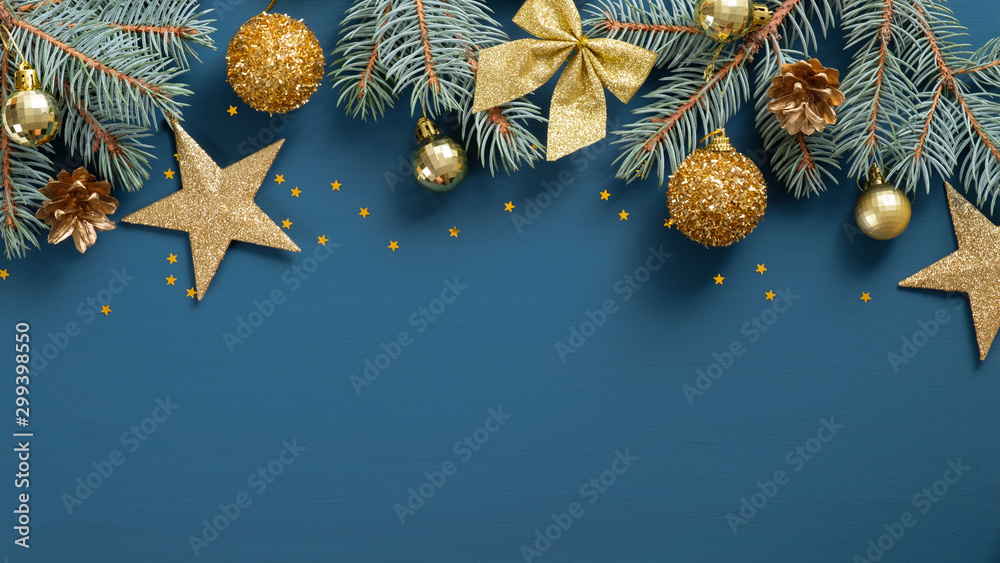 Fototapety, obrazy: Christmas frame top border made of fir tree branches, golden decorative stars, balls over blue background. Flat lay, top view. Xmas banner mockup with copy space