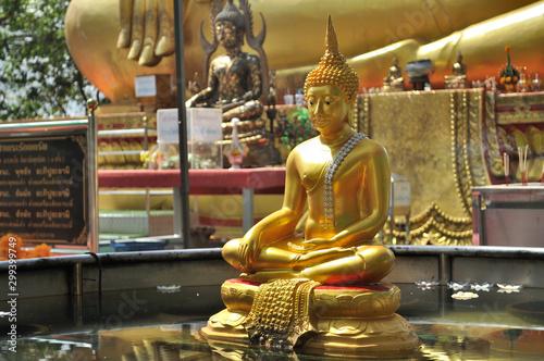 Golden statue of a seated Buddha in the Wat Pra Yai temple (Big Buddha Hill).