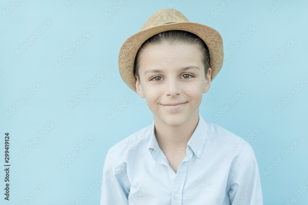 Fototapety, obrazy: Photo of adorable young happy boy looking at camera.Isolated on the blue background
