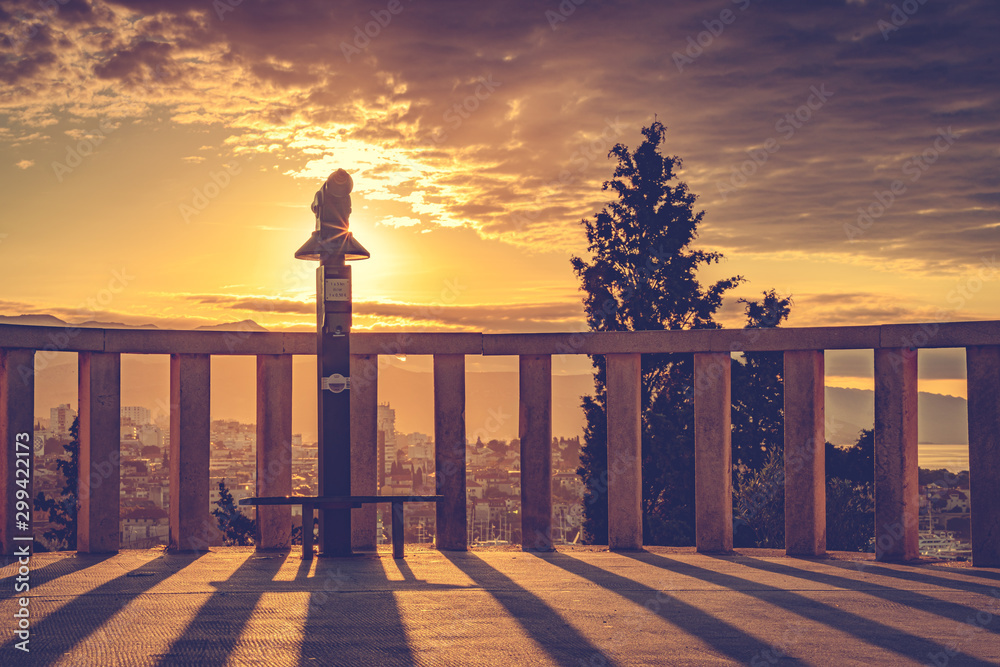Fototapety, obrazy: Silhouette of spyglass over scenic view of old town and port of Split at sunset. Holidays in Croatia
