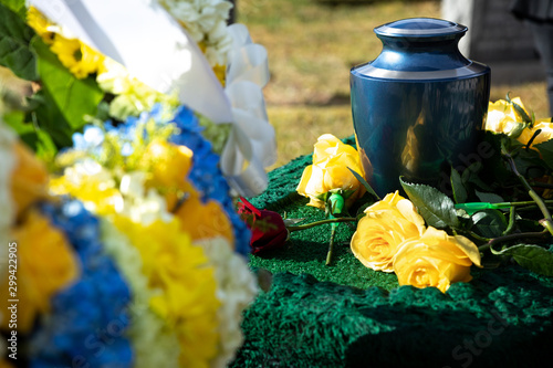 Cremation urn at a funeral, with flowers in the foreground Canvas