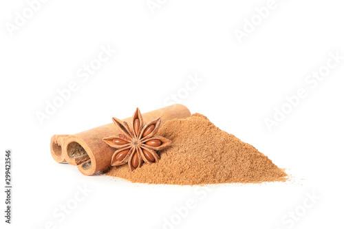 Fototapeta Cinnamon powder, sticks and fragrant anise isolated on white background obraz