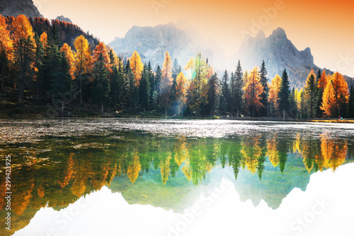 Foto auf Gartenposter Wasserfalle Lake with reflection of mountains at sunrise in autumn in Dolomites, Italy. Landscape with Antorno lake, blue fog over the water, trees with orange leaves and high rocks in fall. Colorful forest