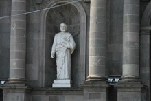 Statue Of Man In Front Of Buil...