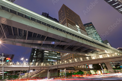 Fotografie, Tablou  Modern architecture. Elevated Highways and skyscrapers in Tokyo.