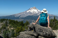 A Mature Woman Hiker Sites On ...