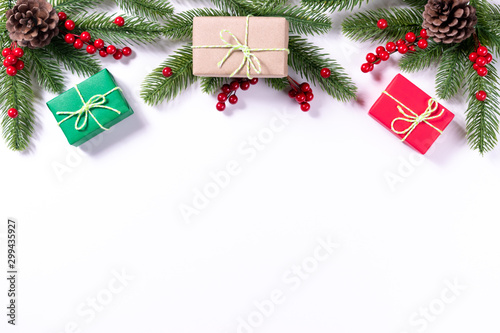 Fototapeta Christmas composition. Gifts, fir tree branches, red berries on white background. Christmas, winter, new year concept. obraz na płótnie