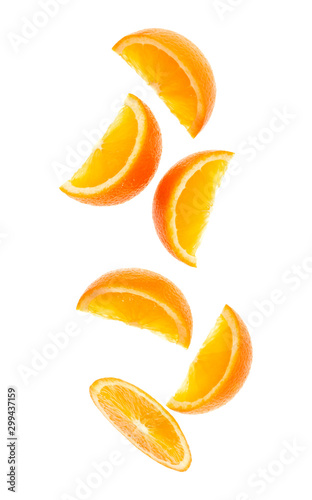 falling fresh orange fruit slices isolated on white background closeup. Flying food concept. Top view. Flat lay. Orange slice in air, without shadow. Fototapete