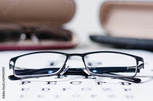 Photo glasses and Eyeglasses on table of check of vision close up - Myopia or hyperopi