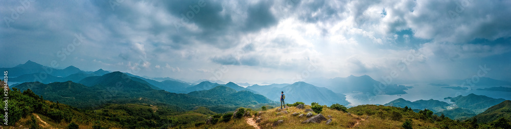 Fototapeta Panorama of Man hiking in mountain, Autumn, Sai Kung