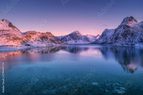 Foto op Canvas Candy roze Aerial view of snow covered mountains and sea at colorful sunset