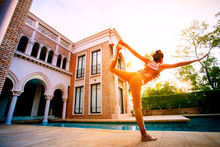 Woman Posting Warrior Yoga Pos...
