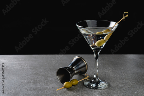 Drink Dry Martini with Green Olives on Stone Background. Canvas Print