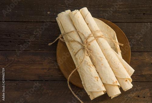 Fotobehang Brood Armenian flat bread lavash. Pita bread on wooden cutting board. Copy space.
