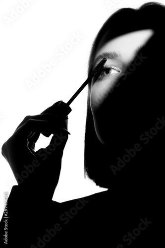 Epic promotional portrait of a girl with applicator and mascara brush Wallpaper Mural