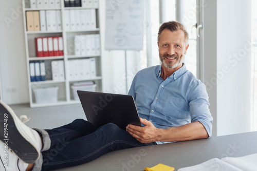 Smiling modern confident casual businessman
