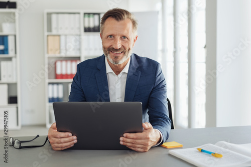 Happy friendly confident businessman